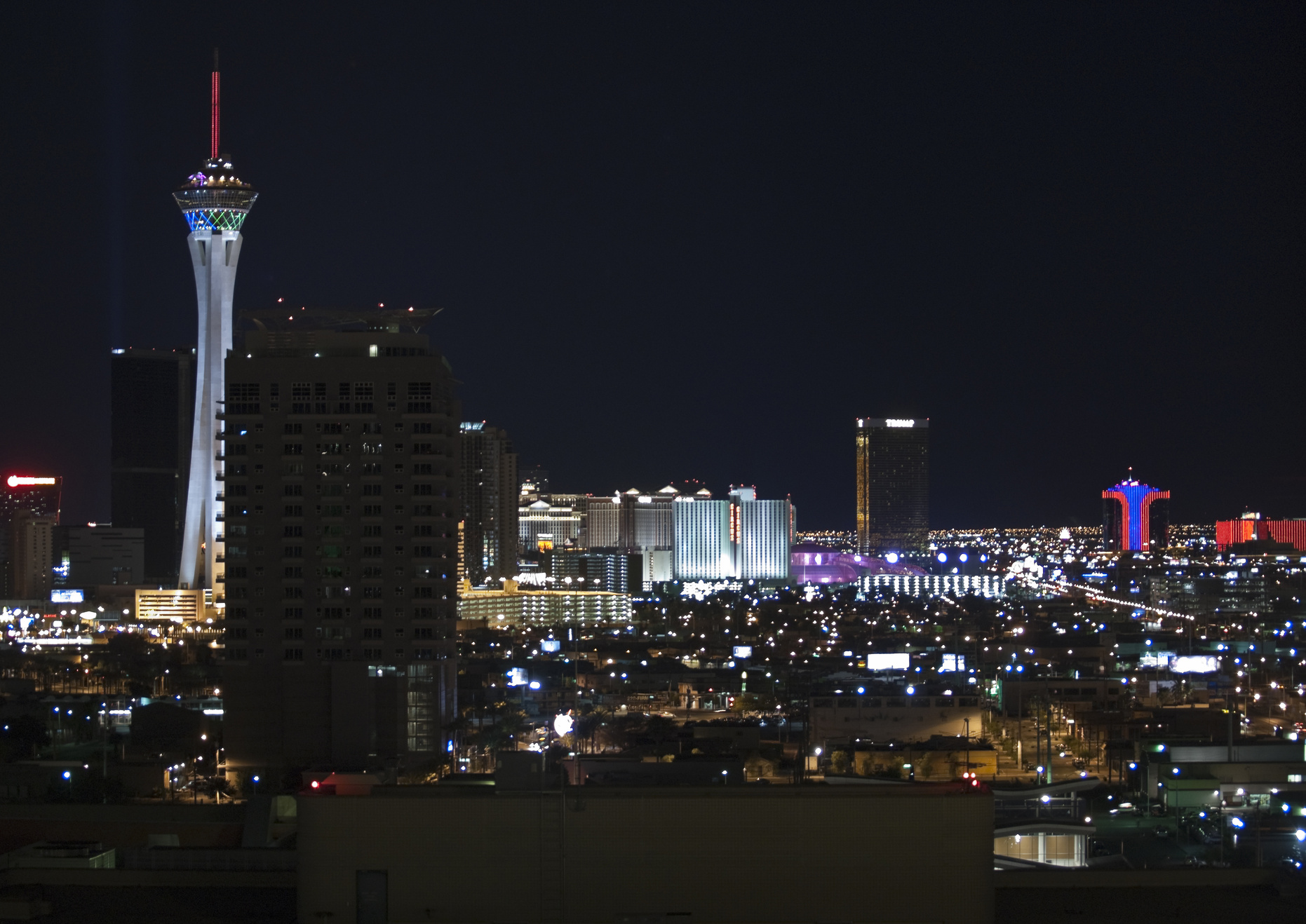 Stratosphere, Circus Circus and other Vegas resorts at night.